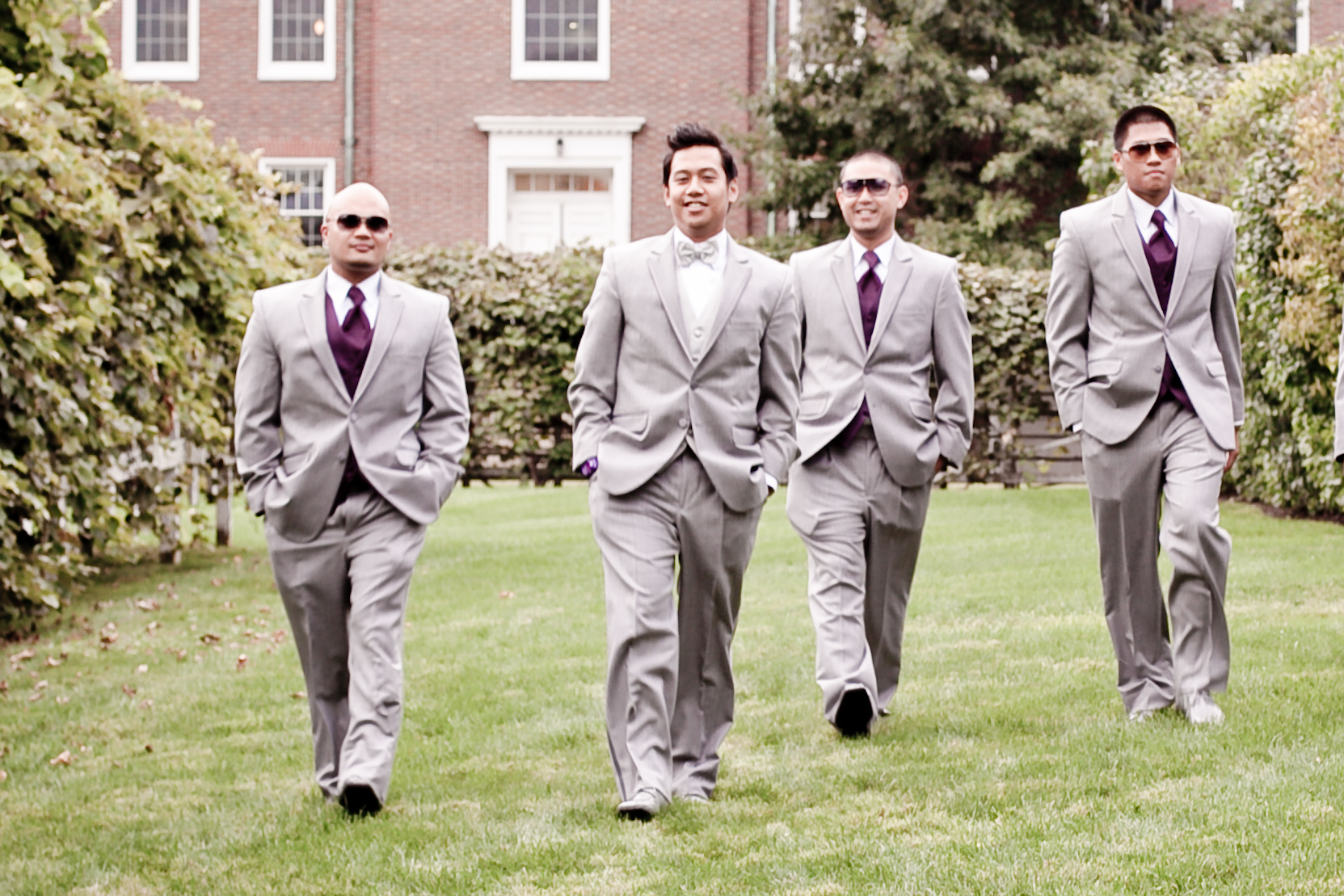 The groom and groomsmen wore grey tuxedos rented from Classic Tuxedo in